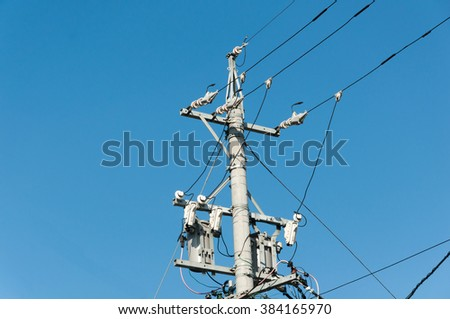 electric pole power lines and wires with blue sky - stock photo