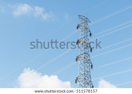 Electric pole. Power lines in the blue sky