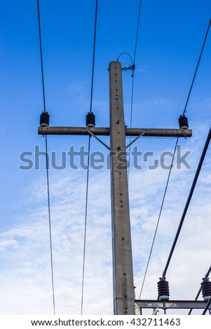 Electric pole with electric wire tangled in vertical view