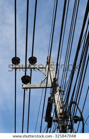 electric pole with many wire on blue sky background