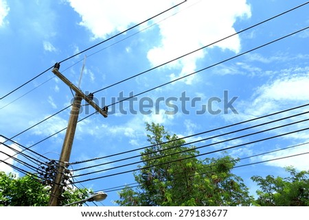 electric pole with tree behind