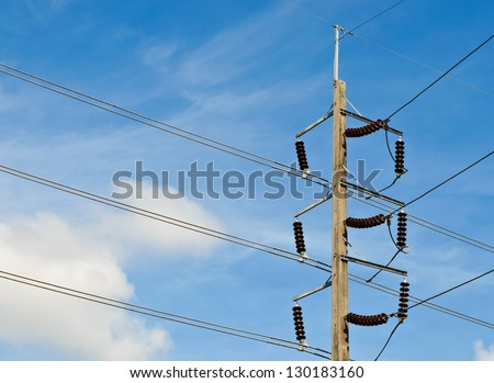 Electric pole  with wires against blue sky - stock photo