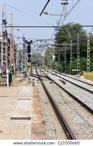 Electric poles by railway track on station - stock photo
