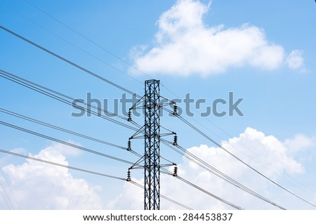 Electric post. High-Voltage Electric Tower in the blue sky background.