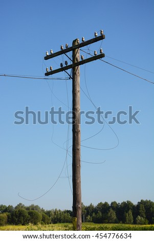 Electric post power pole. Wire breakage after hurricane. Broken power line. Hurricanes caused more damage than expected including loss of electricity for thousands of homes. - stock photo