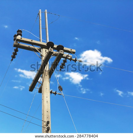 electric post with blue sky background - stock photo