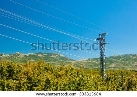 Electric power lines and pylon. - stock photo