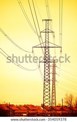 Electric power lines and pylons  in sunset