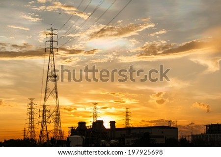 Electric power plant at sunrise - stock photo