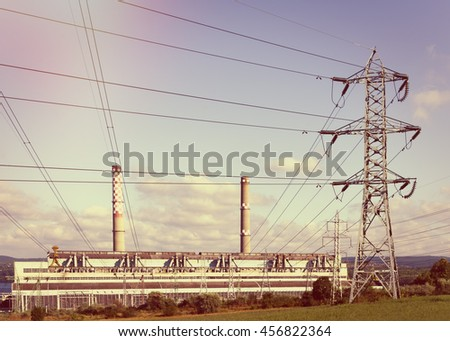 Electric power plant at sunset  - stock photo