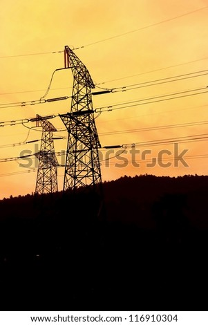 Electric power pylon with sunset glow.