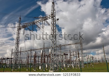 Electric power station in the countryside against a cloudy sky