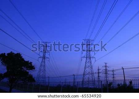 Electric power station on blue sky. - stock photo