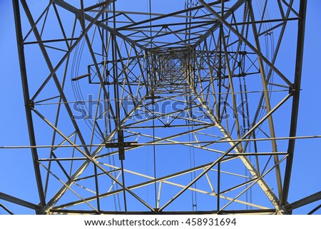 Electric power tower in blue sky