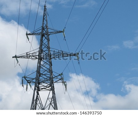 Electric power transmission line tower - stock photo