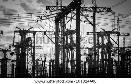 Electric Pylons in black and white - stock photo