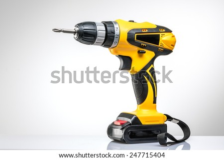 electric screwdriver on a white background - stock photo