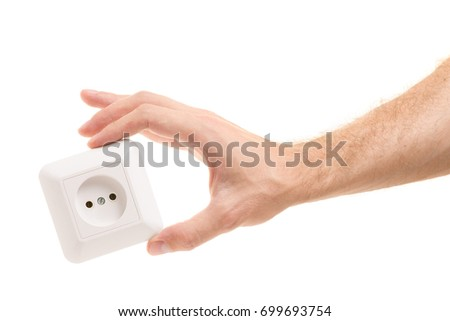Electric socket in a hand on a white background isolation