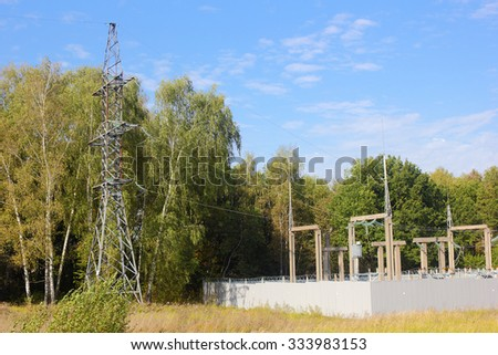 Electric substation and line support in the forest photo