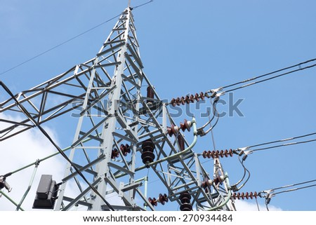 Electric substation tower with blue sky, generating energy background  - stock photo