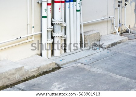 electric system. Industrial steel electric system and ventilation systems. Exterior wall of electrical boxes and conduit. electric power station, inside. pipe electric system.
