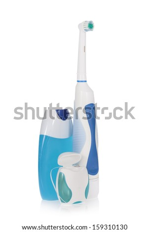 Electric toothbrush, toothpaste and dental floss  isolated on white background  - stock photo