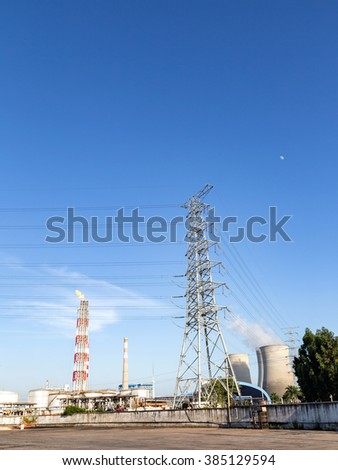 Electric tower and the cooling tower in the blue sky white cloud background