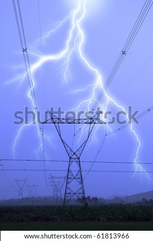 electric tower during the thunderstorm - stock photo