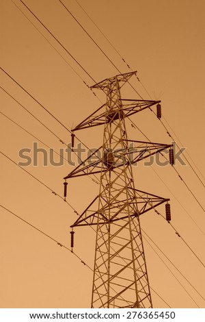 electric tower in the blue sky, steel power transmission facilities - stock photo