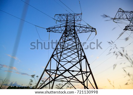 Electric tower with sky background. High voltage