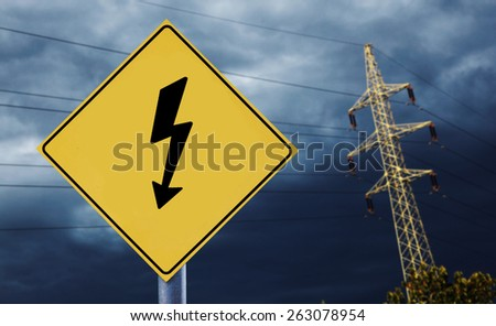 Electric towers at moonlight with electricity label - stock photo