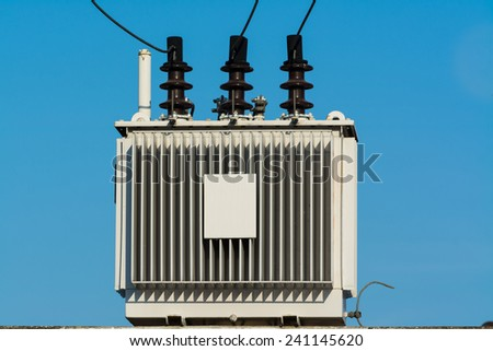 Electric transformer against with blue sky - stock photo