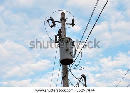 Electric transformer on a column - stock photo