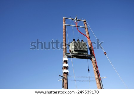 Electric transformer substation against a blue sky