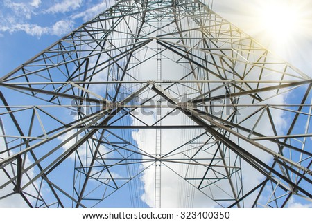 Electric Transmission Tower.electricity transmission pylon silhouetted against blue sky at dusk  - stock photo