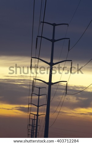 Electric utility poles at sunset