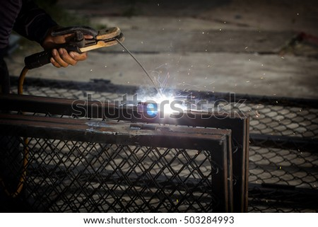 electric welding in worker hand