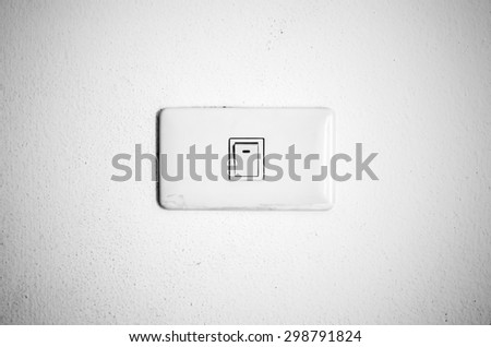 electric white switch on wall black and white color tone style