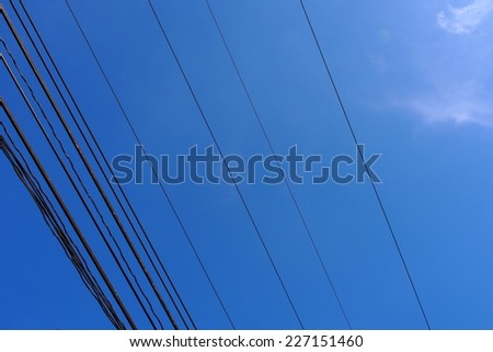 Electric wire in the sky as a backdrop. - stock photo