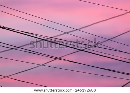electric wires at sunset - stock photo