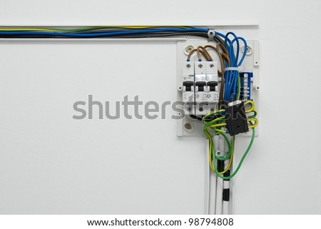 Electric wiring on a wall - stock photo