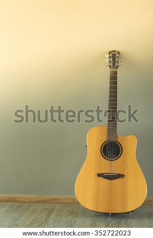 electric wooden guitar with background
