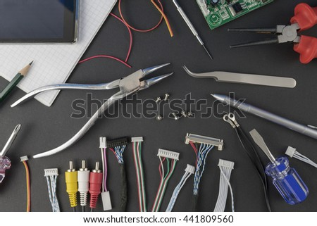 Electrical and electronic engineering, tools and components on the table of an engineer, technician, or researcher.
