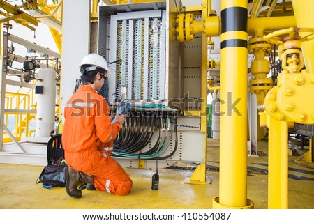 Electrical and instrument technician maintenance electric system at oil and gas processing platform