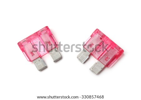 Electrical automotive fuses or circuit breakers on white background - stock photo
