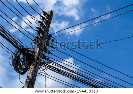 electrical cables with blue sky - stock photo