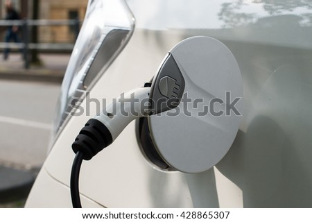 Electrical car charging from public battery charging system, selective focus