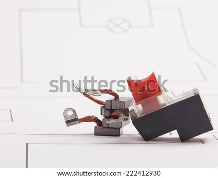 Electrical. carbon brush and drill start button on a background of the electric scheme - stock photo
