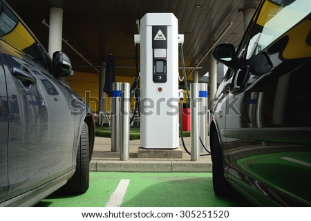 Electrical cars charging battery at station - stock photo