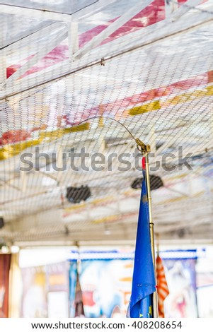 electrical contact in dodgems, small electric cars in a small town fair - stock photo